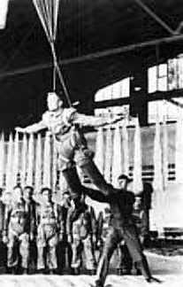 German parachute during suspended harness training, notice he has no control of his canopy